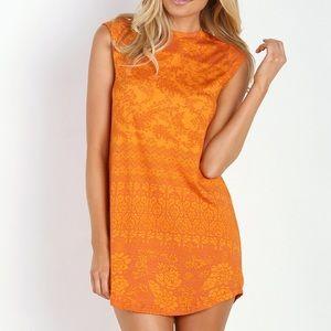 Novella Royale Goldie Dress in Tangerine Hazely.